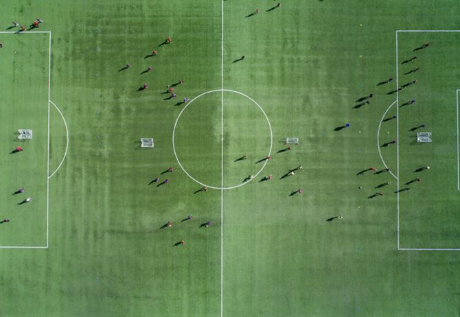 Aerial view of a soccer , football match. Football field and Footballers