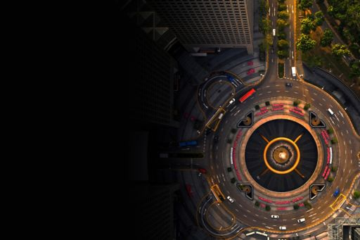 Aerial view of cars driving around a roundabout