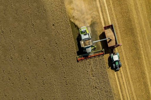 Aerial view of tractor cultivating on a farm