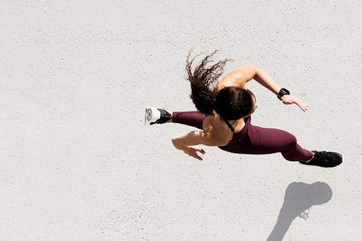 Aerial view of woman in activewear running
