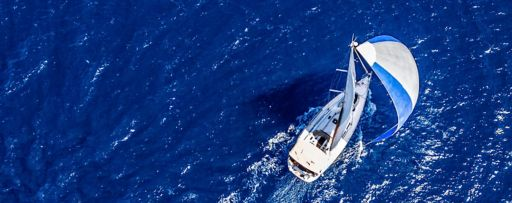 Aerial view of yacht sailing in the ocean
