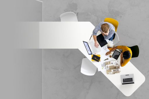 Aerial view of two business people together working on a project