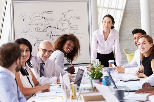 Businesswoman leading a meeting at the boardroom table