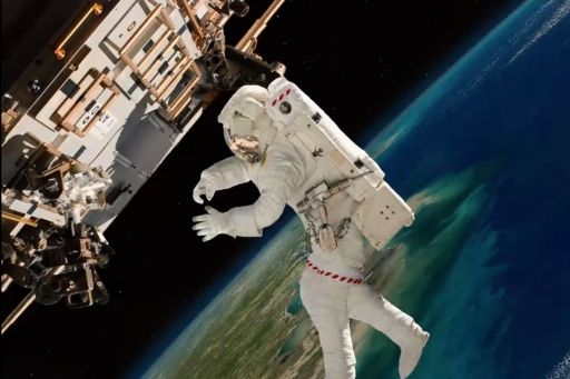 Astronaut walking in space, Earth in the background
