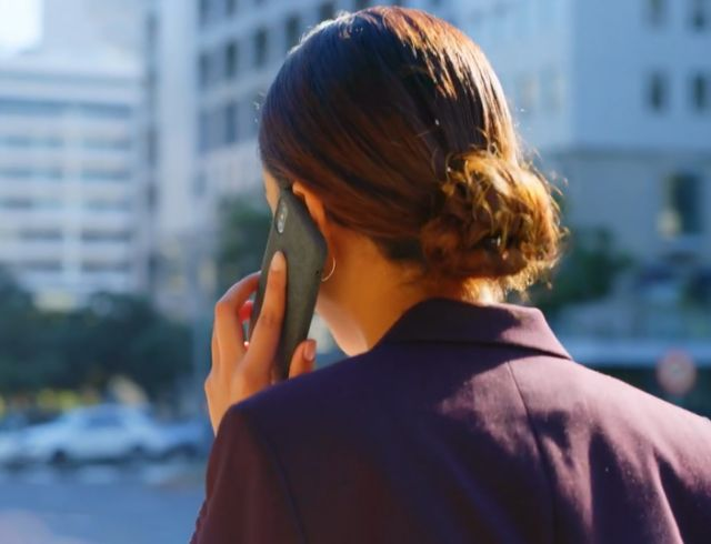 Back view of a businesswomen wearing formals talking phone