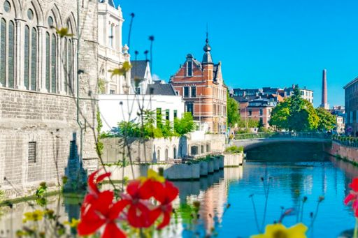 Buildings on river side and flowers blooming