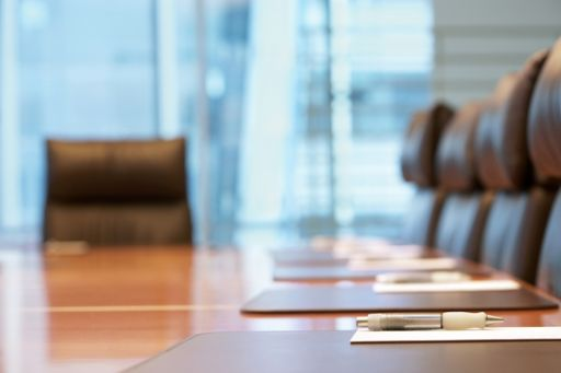 Chairs around a boardroom table