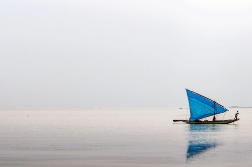 boat-with-blue-flag