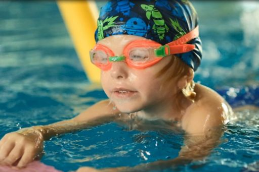 Boy wearing safety glasses swimming