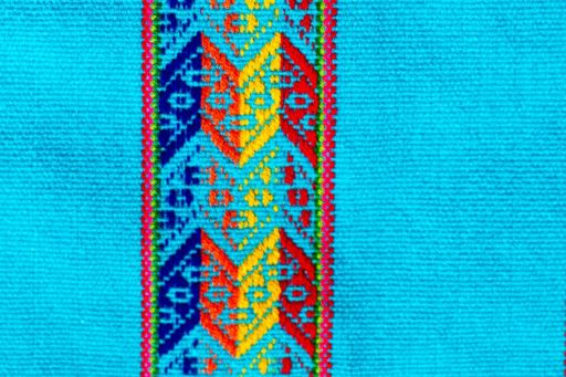 Bright blue fabric with vertical patterned design