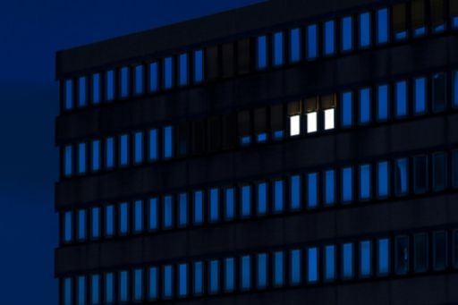 building with only three lights on