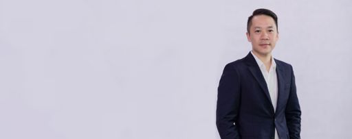 Business man standing smartly against white background