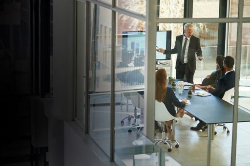 Business meeting viewed from outside an office window