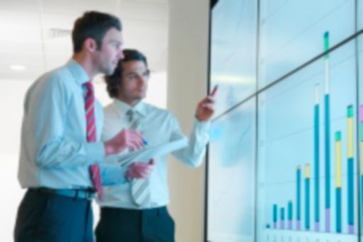 Businessmen looking at the graphs