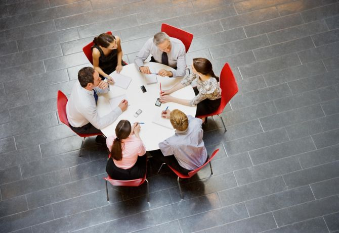 business people having a meeting around table