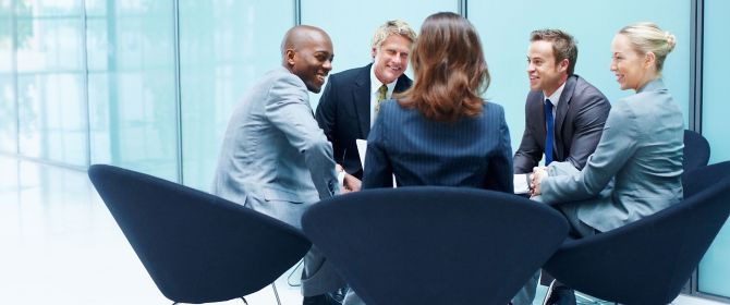 Business people talking about risk