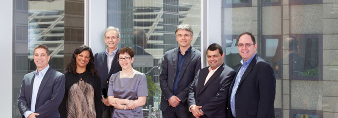 Business people standing infront of glass building
