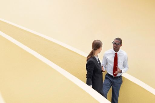 Business people talking on a staircase