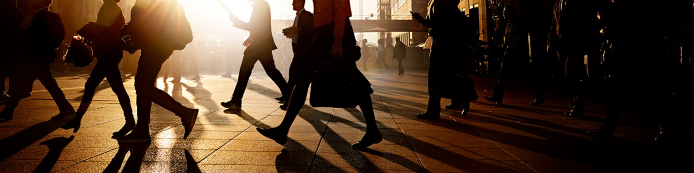 Business people walking on a pavement