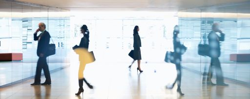reflection of business people walking