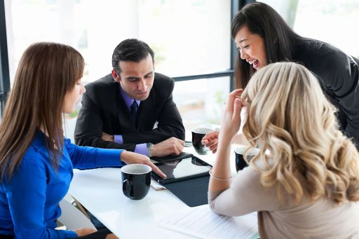 Business team using tablet in office meeting