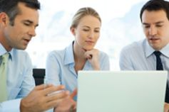 Business team looking at computer screen