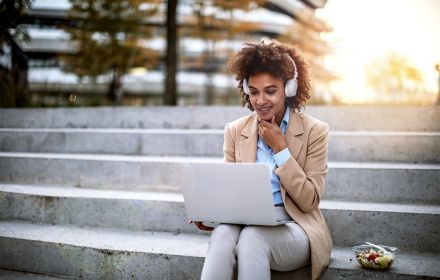 Business woman on a lunch break outdoors using laptop