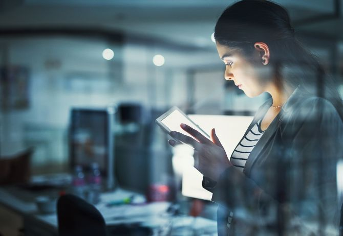 Business woman reading something on tablet