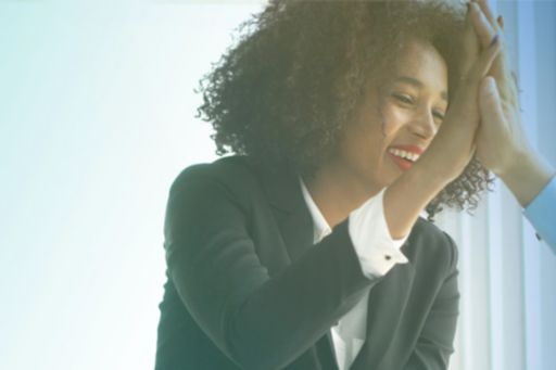 Business woman sitting and smiling