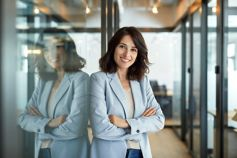 Business woman standing with arms folded