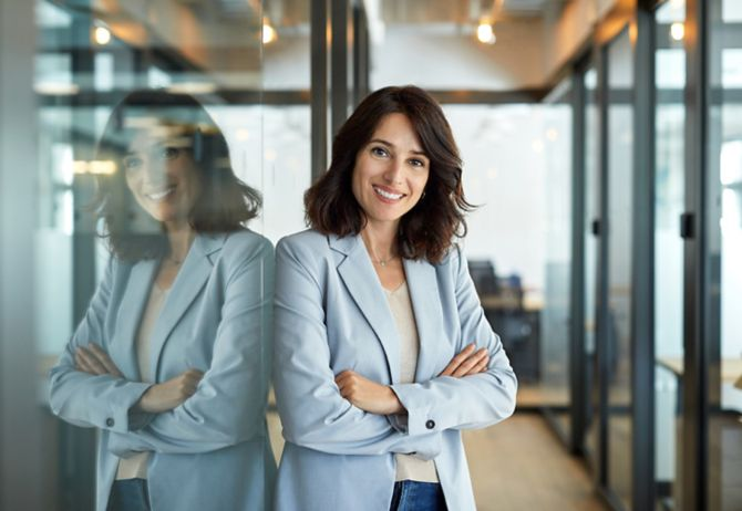 Business woman standing with folded arms