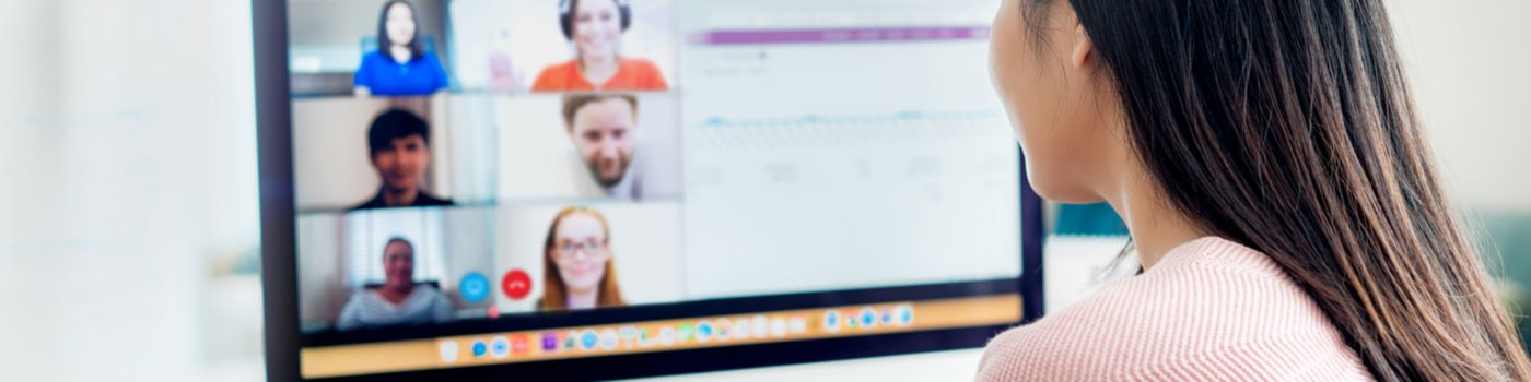 Business woman talking to colleagues in video conference