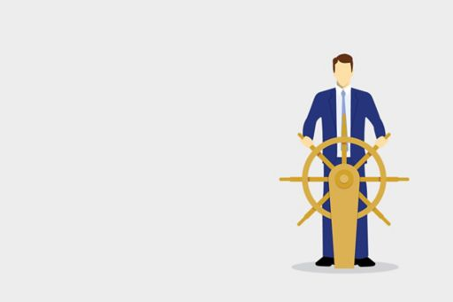 Businessman at a ship's wheel