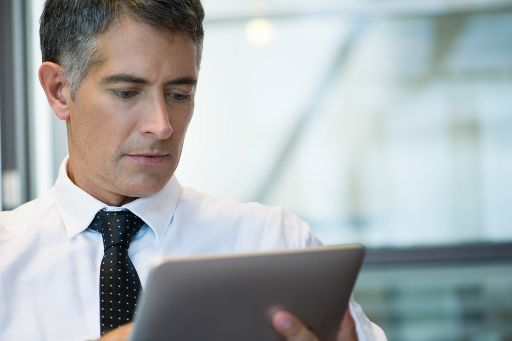 A businessman with a tablet
