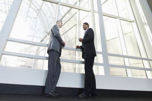 Businessmen talking together in lobby