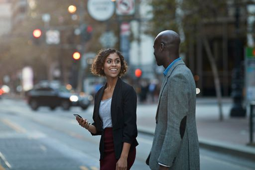 Businesspeople walking and talking on avenue
