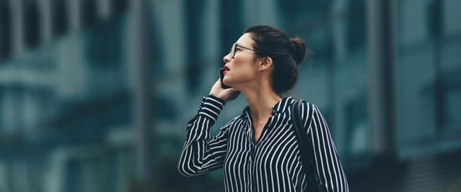 Side-view of a businesswomen talking on phone