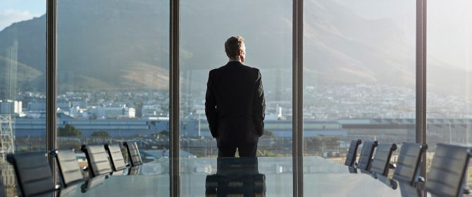 Man looking out of office