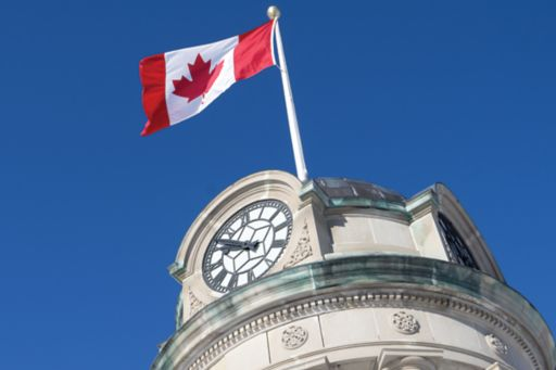 Canadian flag flying on building