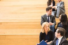 Graduates - How to apply - young professionals chatting on steps