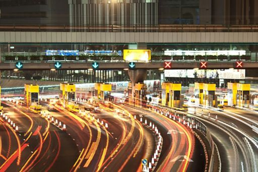 Cars going through a toll booth.