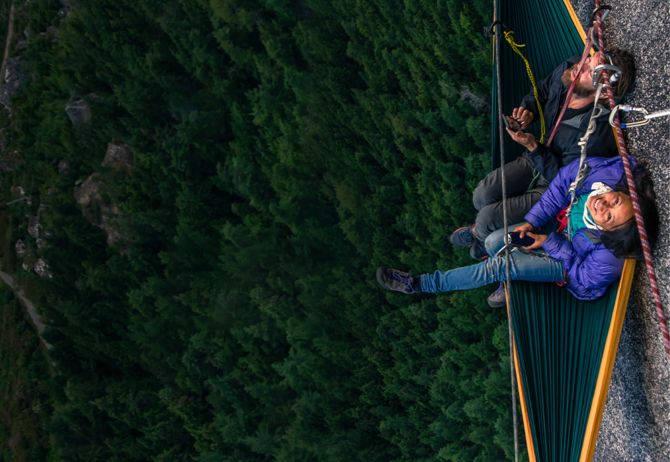 Changing Futures - Strategy - Climbers resting on a cliff