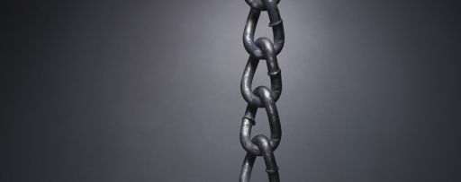 chain with gold link on black wall