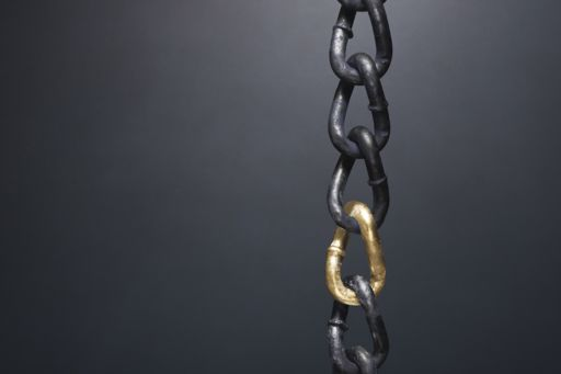 chain with gold in the middle
