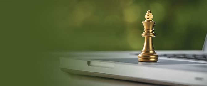 Chess piece on a laptop