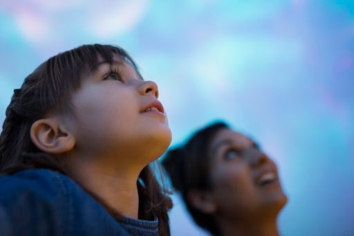 Child looking up at the sky