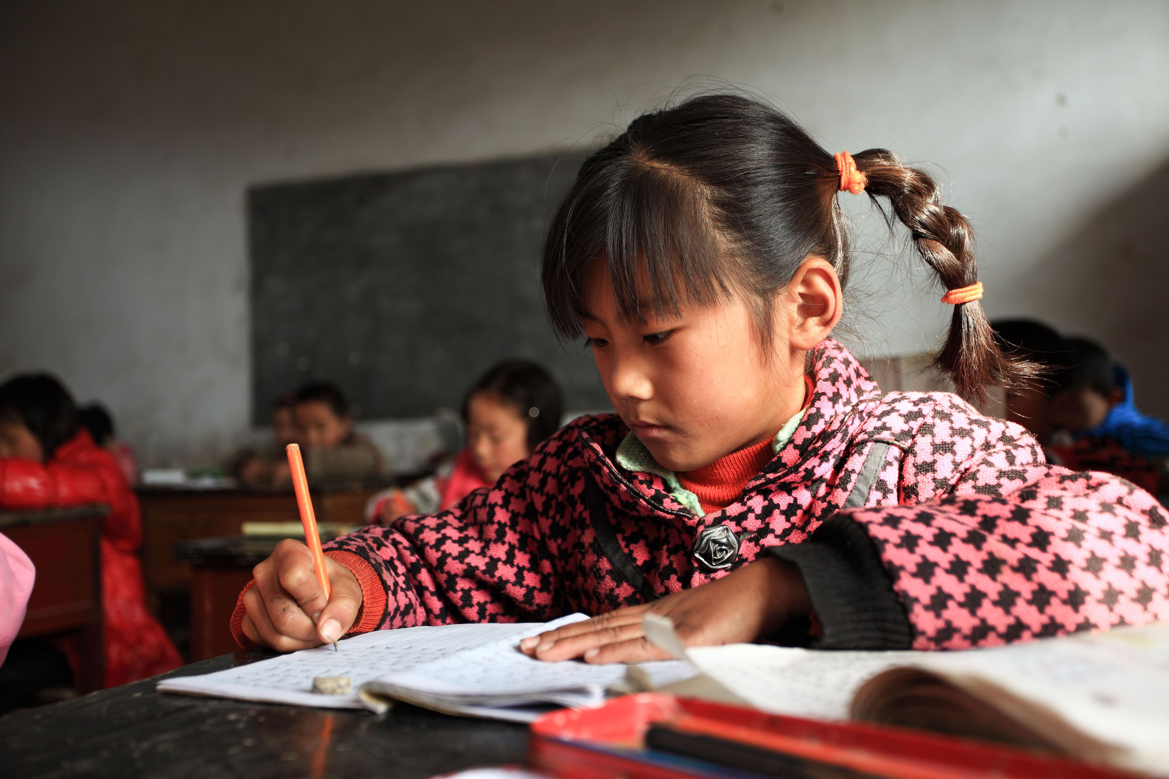 girl studying in a rural asian classroom
