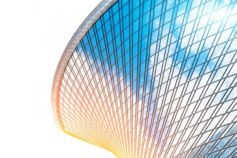 Circular glass building against white background