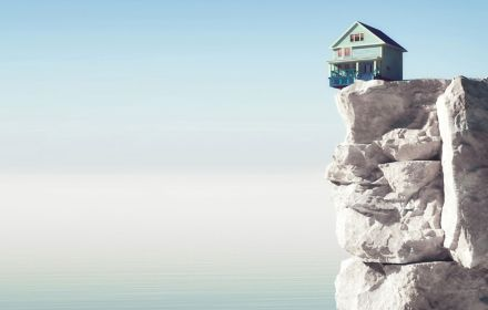 house on topof a beach cliff
