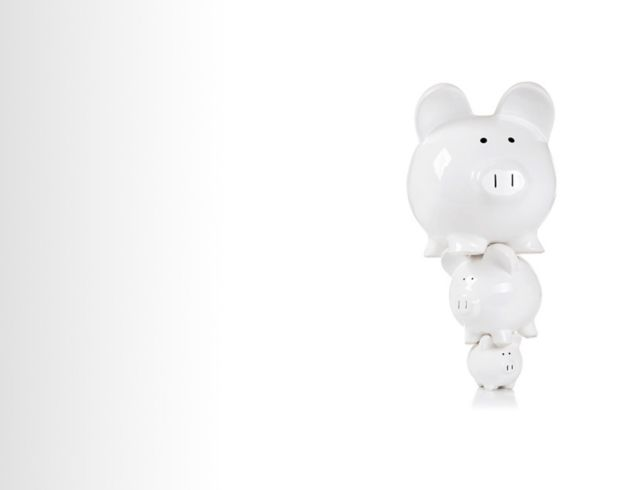 three white piggybank of different sizes